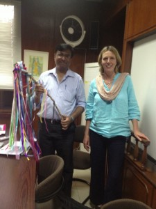 Clare with a collegue at the NRSP in Pakistan with the Rainbow Stick!