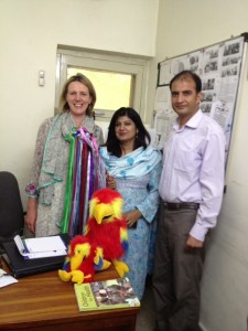 Clare and colleagues in Islamabad with the parrots and the rainbow stick