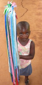 A child carries a Rainbow Stick, Tsangano, Mozambique