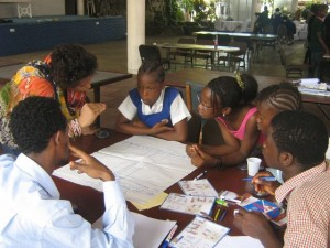 Children discussing and filling in an Opportunities Chart in Sierra Leone