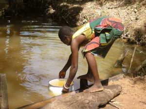 Adolescent girl fetching water.