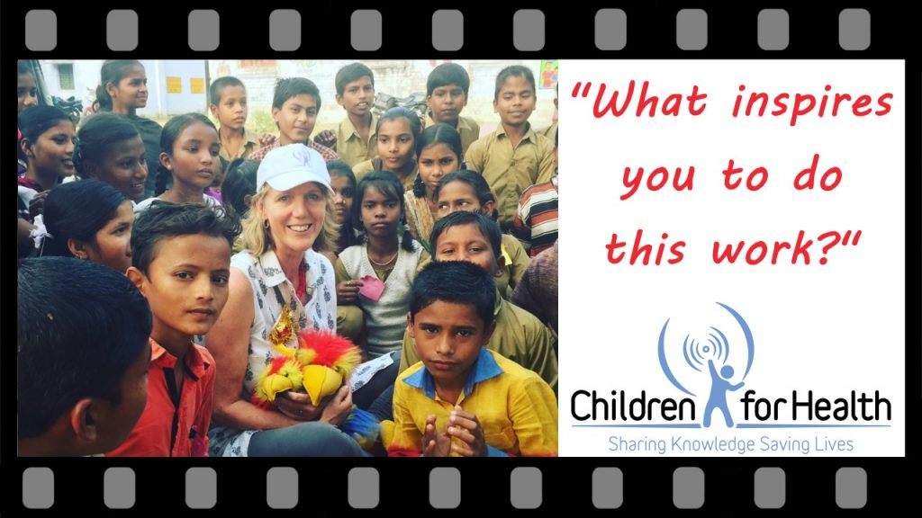 Photo of Clare Hanbury with a group of children, on the right it reads, 'What inspires you to do this work?'